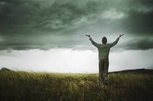 Man with arms raised towards the sky